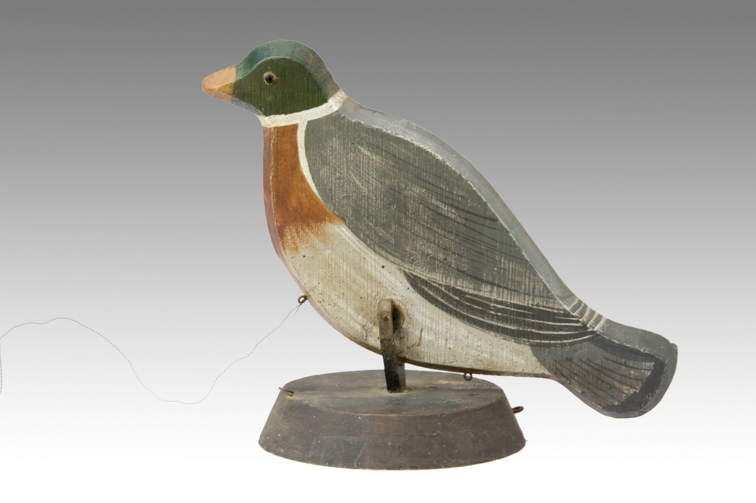 Image of A Pecking Decoy Bird