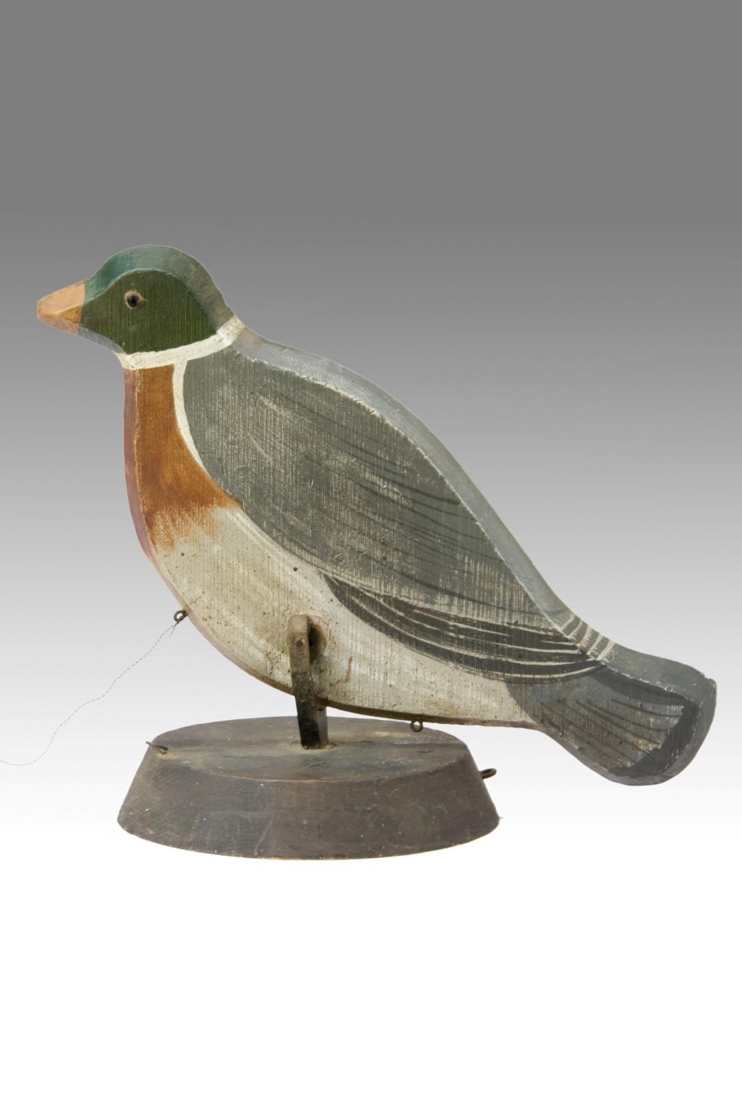 A Pecking Decoy Bird