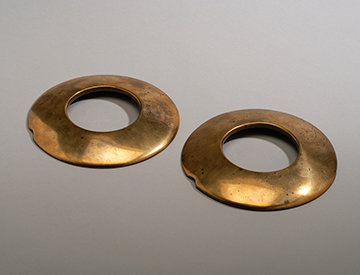 A Pair of Bronze Pub Quoits