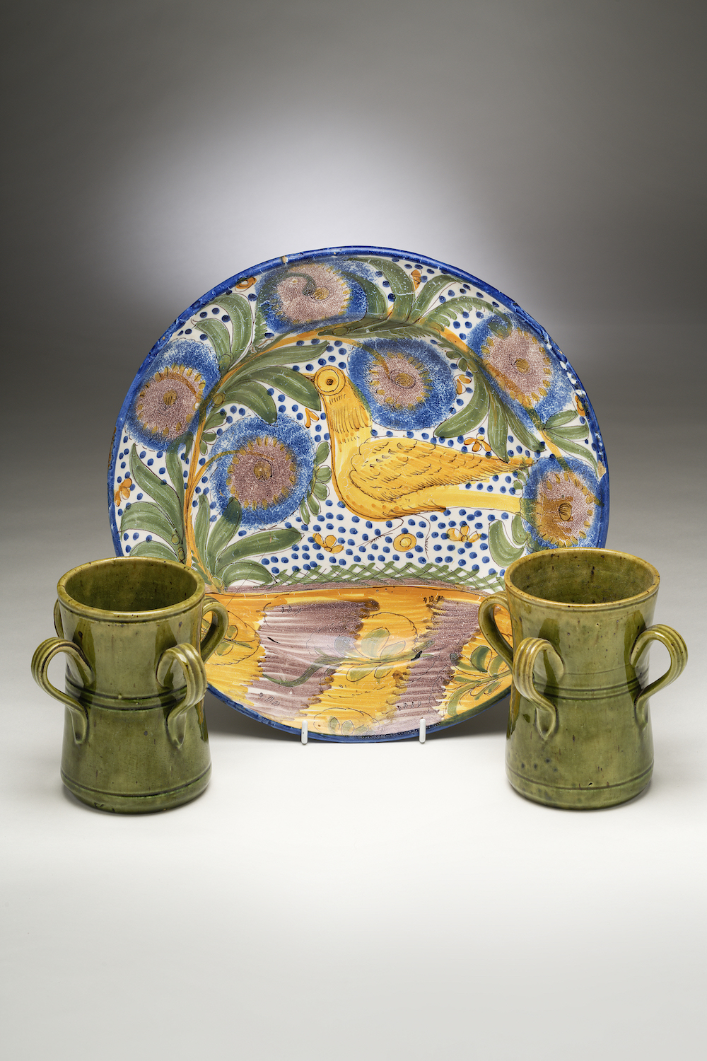 Image of A Polychrome Charger & Pair of Olive-green Tygs